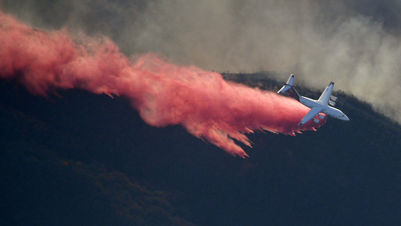 <div class='meta'><div class='origin-logo' data-origin='AP'></div><span class='caption-text' data-credit='AP Photo/Mark J. Terrill'>An air tanker drops flame retardant to protect homes as fires burn Friday, Nov. 9, 2018, as seen from a helicopter over the Calabasas section of Los Angeles.</span></div>
