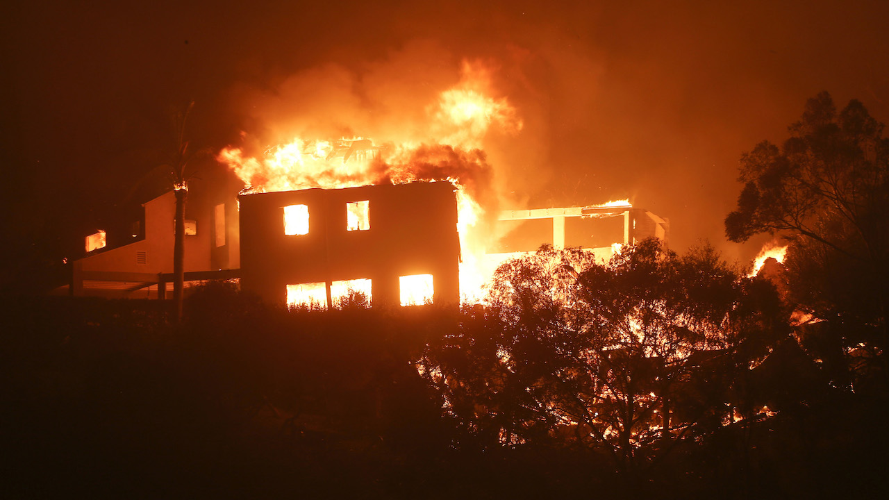 <div class='meta'><div class='origin-logo' data-origin='AP'></div><span class='caption-text' data-credit='AP Photo/Ringo H.W. Chiu)'>The Woolsey Fire burns a home in Malibu, Calif., Friday, Nov. 9, 2018.</span></div>