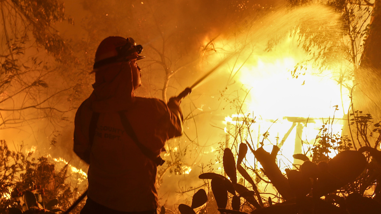 <div class='meta'><div class='origin-logo' data-origin='AP'></div><span class='caption-text' data-credit='AP Photo/Ringo H.W. Chiu'>A firefighter battles the Woolsey Fire in Malibu, Calif., Friday, Nov. 9, 2018.</span></div>