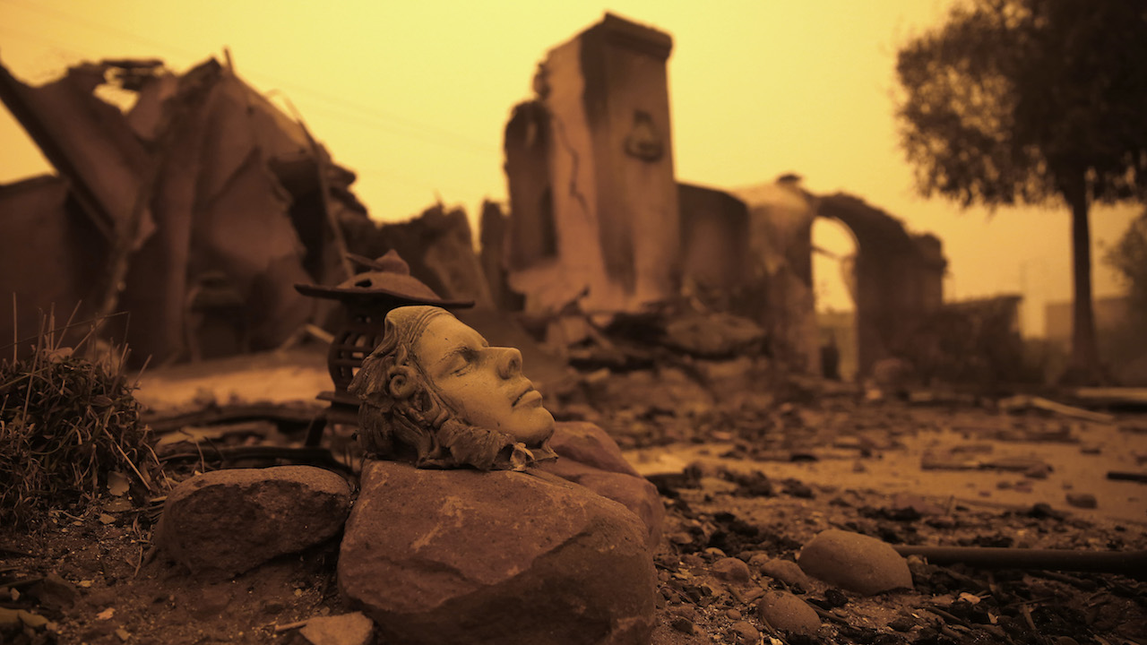 <div class='meta'><div class='origin-logo' data-origin='AP'></div><span class='caption-text' data-credit='AP Photo/Rich Pedroncelli'>A piece of art sits outside the burned remains of home Friday, Nov. 9, 2018, that was destroyed by a wildfire that swept through the area Thursday, in Paradise, Calif.</span></div>