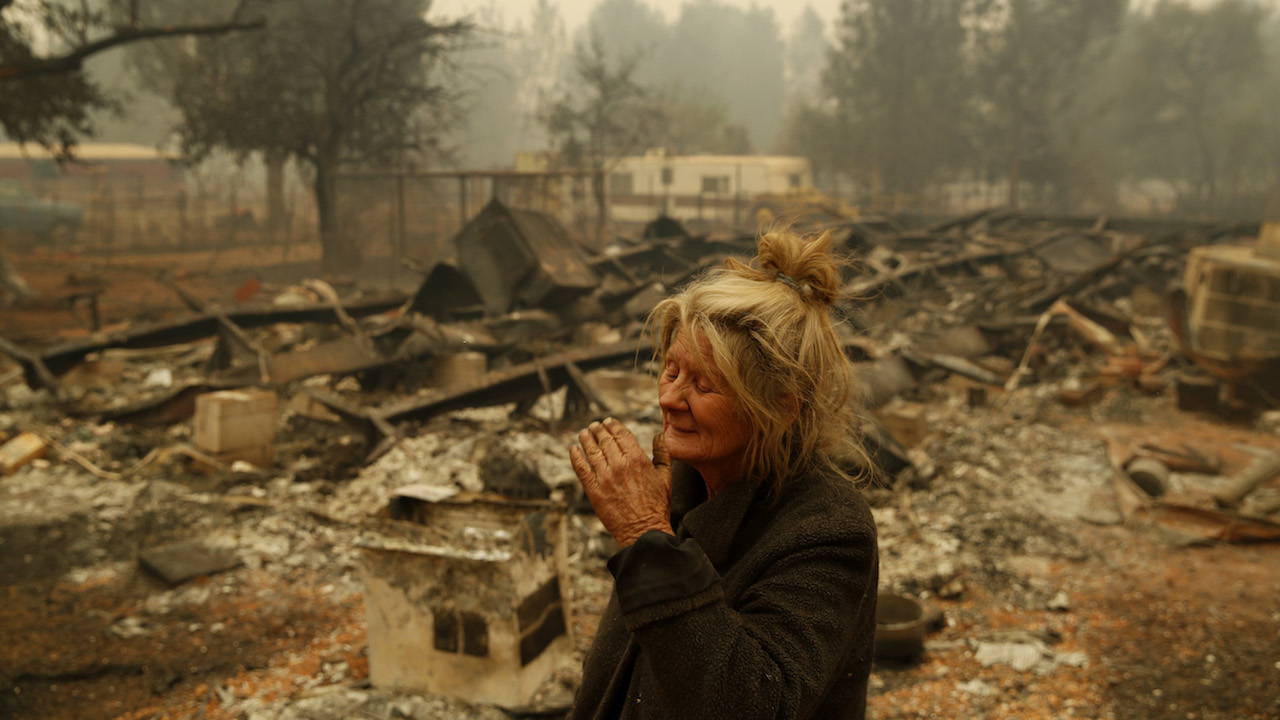 <div class='meta'><div class='origin-logo' data-origin='AP'></div><span class='caption-text' data-credit='AP Photo/John Locher'>Cathy Fallon reacts as she stands near the charred remains of her home, Friday, Nov. 9, 2018, in Paradise, Calif.</span></div>