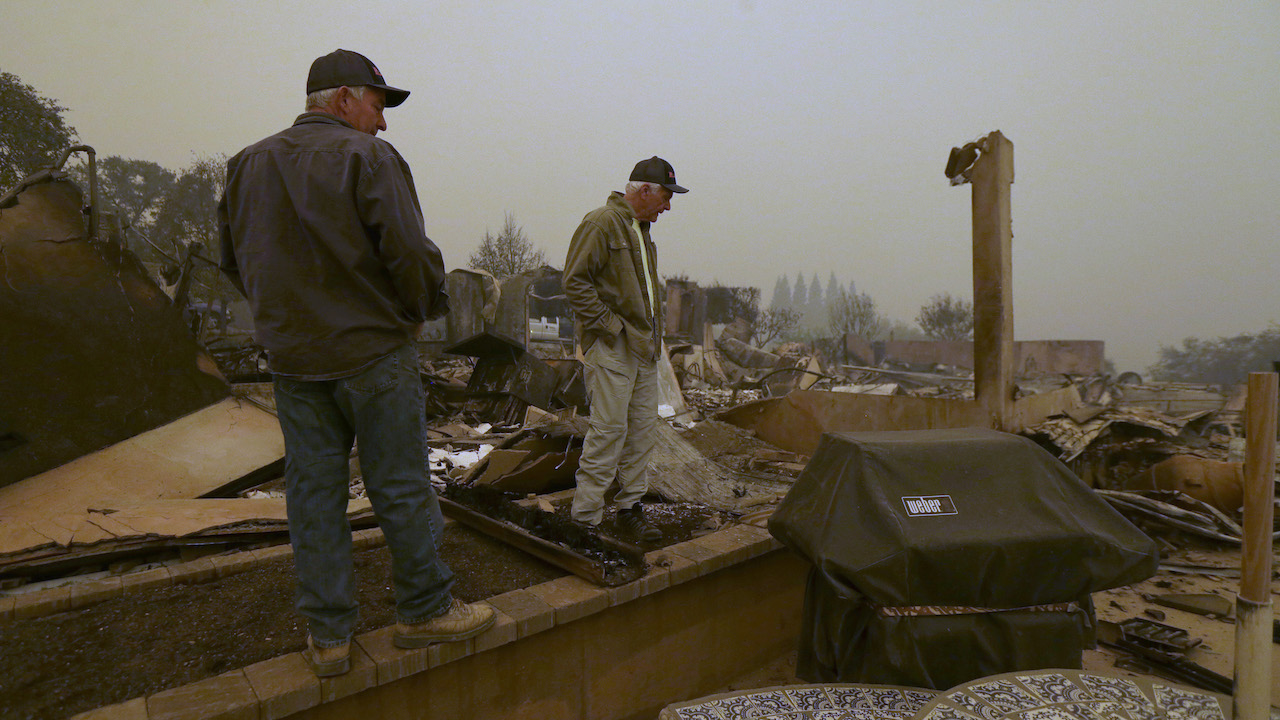 <div class='meta'><div class='origin-logo' data-origin='AP'></div><span class='caption-text' data-credit='AP Photo/Rich Pedroncelli'>Larry Marple, right, accompanied by his son, Rod Marple, looks over the burned remains of his home, Friday, Nov. 9, 2018.</span></div>