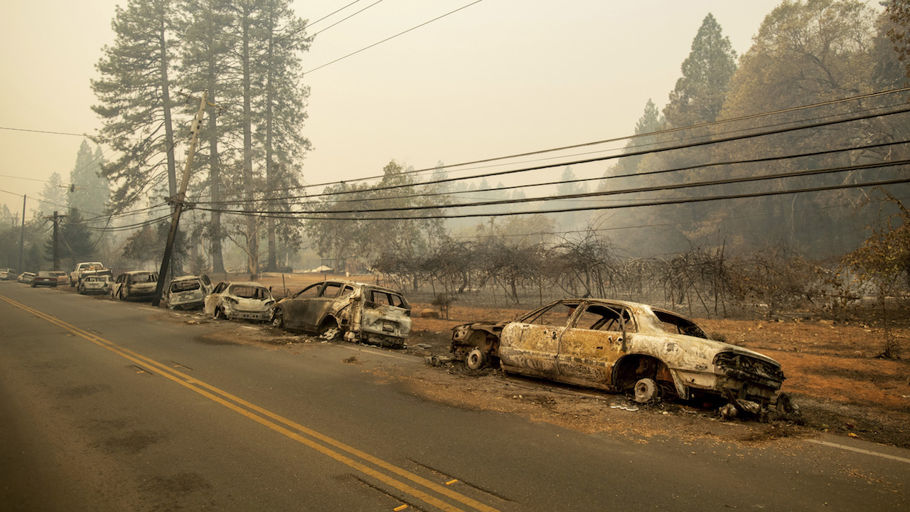 <div class='meta'><div class='origin-logo' data-origin='AP'></div><span class='caption-text' data-credit='AP Photo/Noah Berger'>Abandoned vehicles line Skyway after a wildfire burned through Paradise, Calif., on Friday, Nov. 9, 2018.</span></div>
