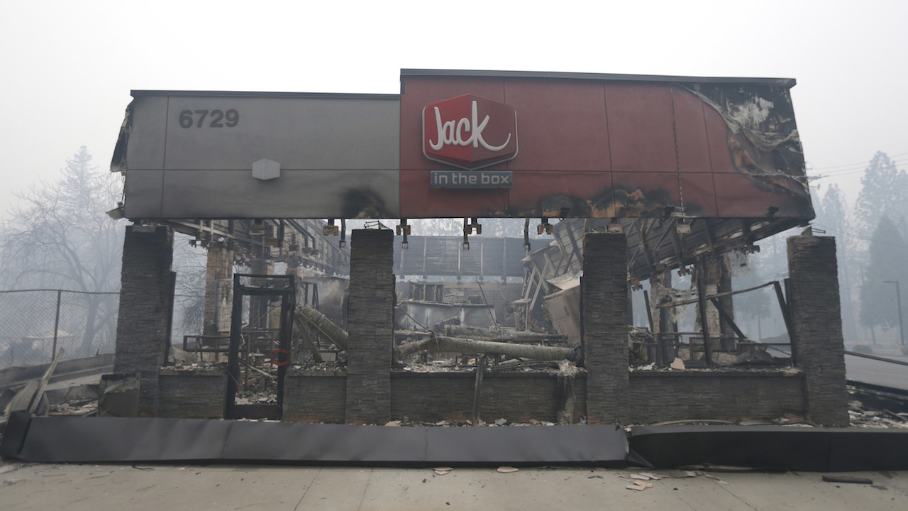 <div class='meta'><div class='origin-logo' data-origin='AP'></div><span class='caption-text' data-credit='AP Photo/Rich Pedroncelli'>A Jack In the Box destroyed by a massive wildfire is seen Friday, Nov. 9, 2018, near Paradise, Calif.</span></div>