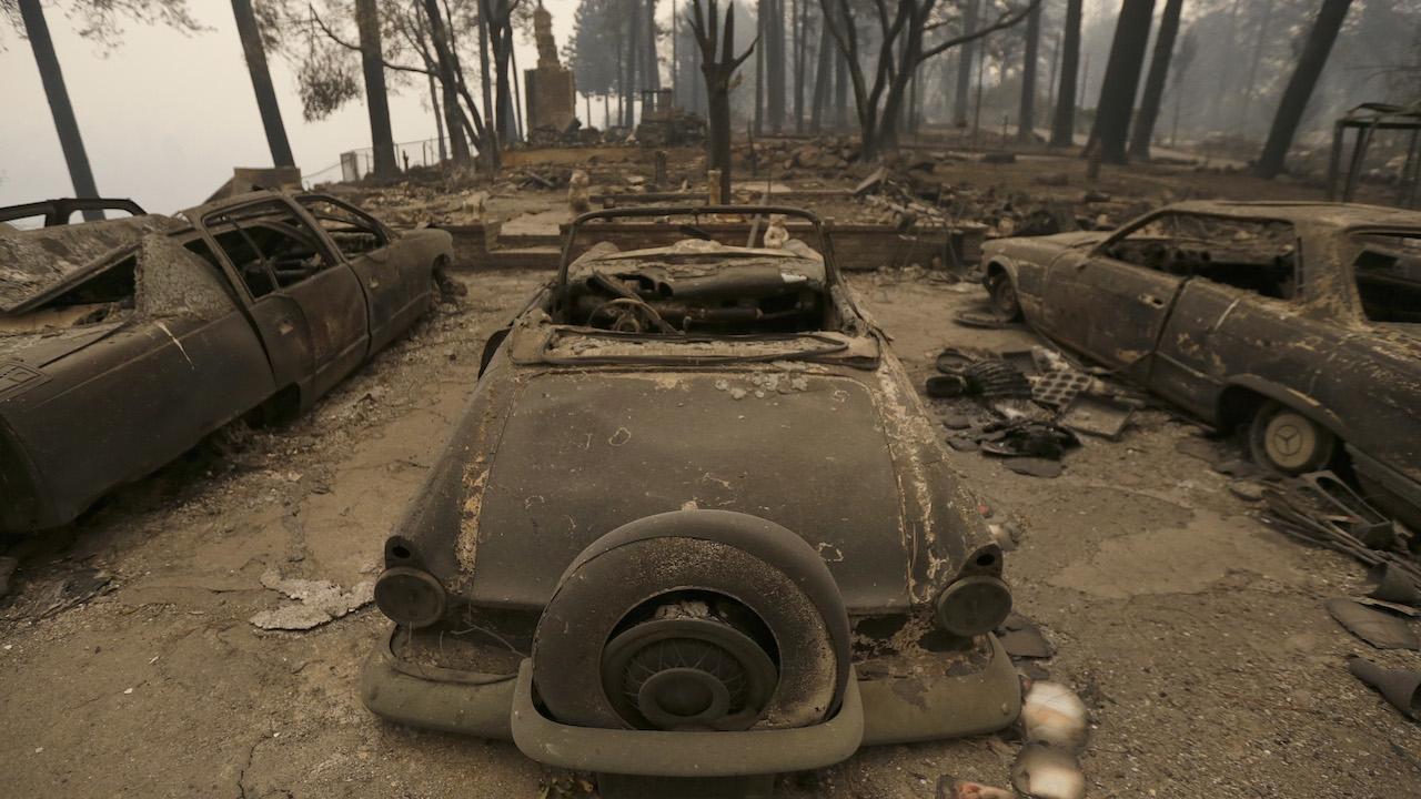 <div class='meta'><div class='origin-logo' data-origin='AP'></div><span class='caption-text' data-credit='AP Photo/Rich Pedroncelli'>Three cars destroyed by a wildfire sit at a burned out home Friday, Nov. 9, 2018, in Paradise, Calif.</span></div>