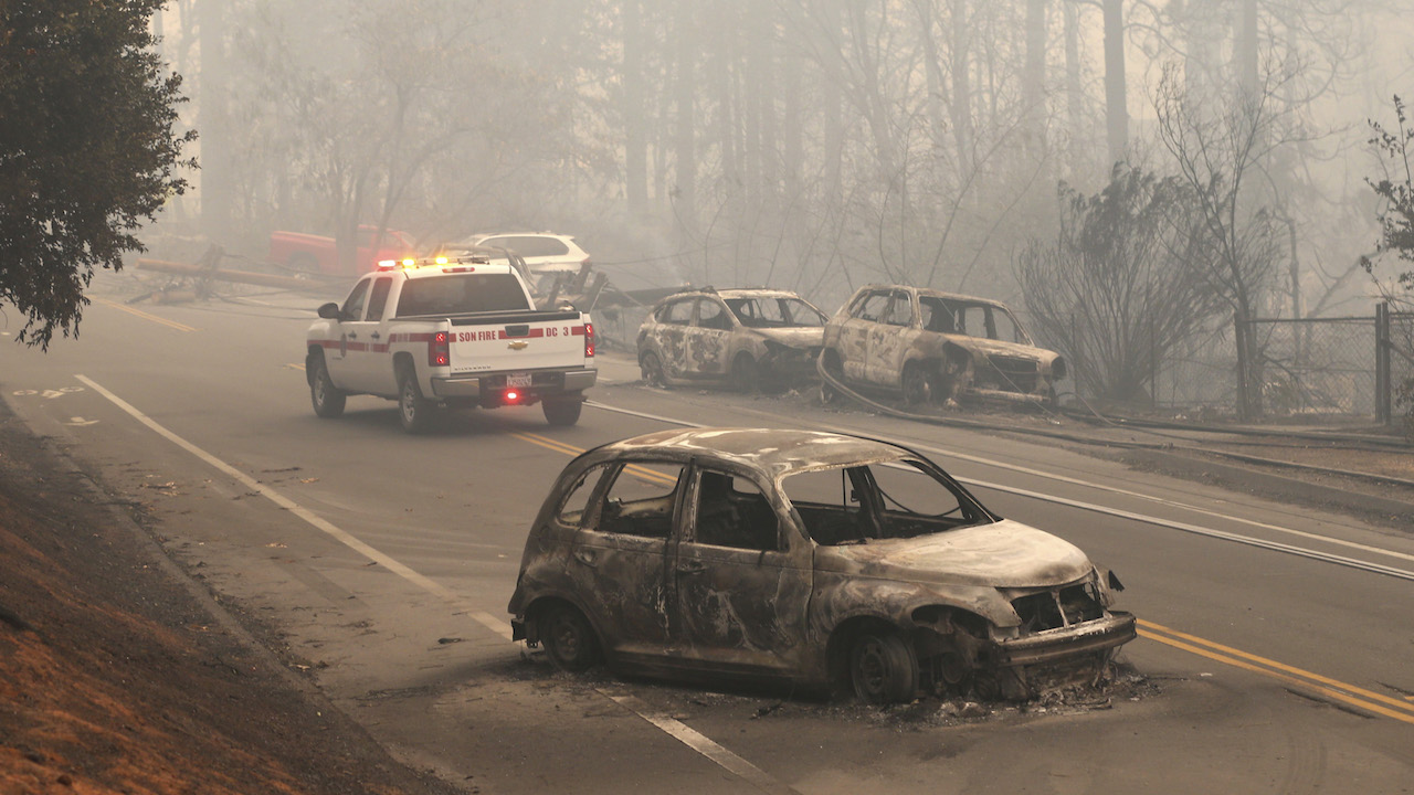 <div class='meta'><div class='origin-logo' data-origin='AP'></div><span class='caption-text' data-credit='AP Photo/Rich Pedroncelli'>The burned-out hulks of cars abandoned by their drivers sit along a road Friday, Nov. 9, 2018, in Paradise, Calif.</span></div>