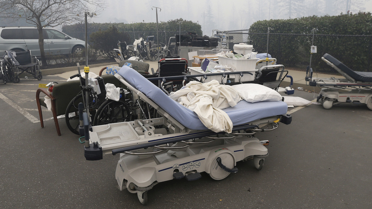 <div class='meta'><div class='origin-logo' data-origin='AP'></div><span class='caption-text' data-credit='AP Photo/Rich Pedroncelli'>Hospital beds and other equipment sit in a parking lot outside the Feather River Hospital Friday, Nov. 9, 2018, in Paradise, Calif.</span></div>