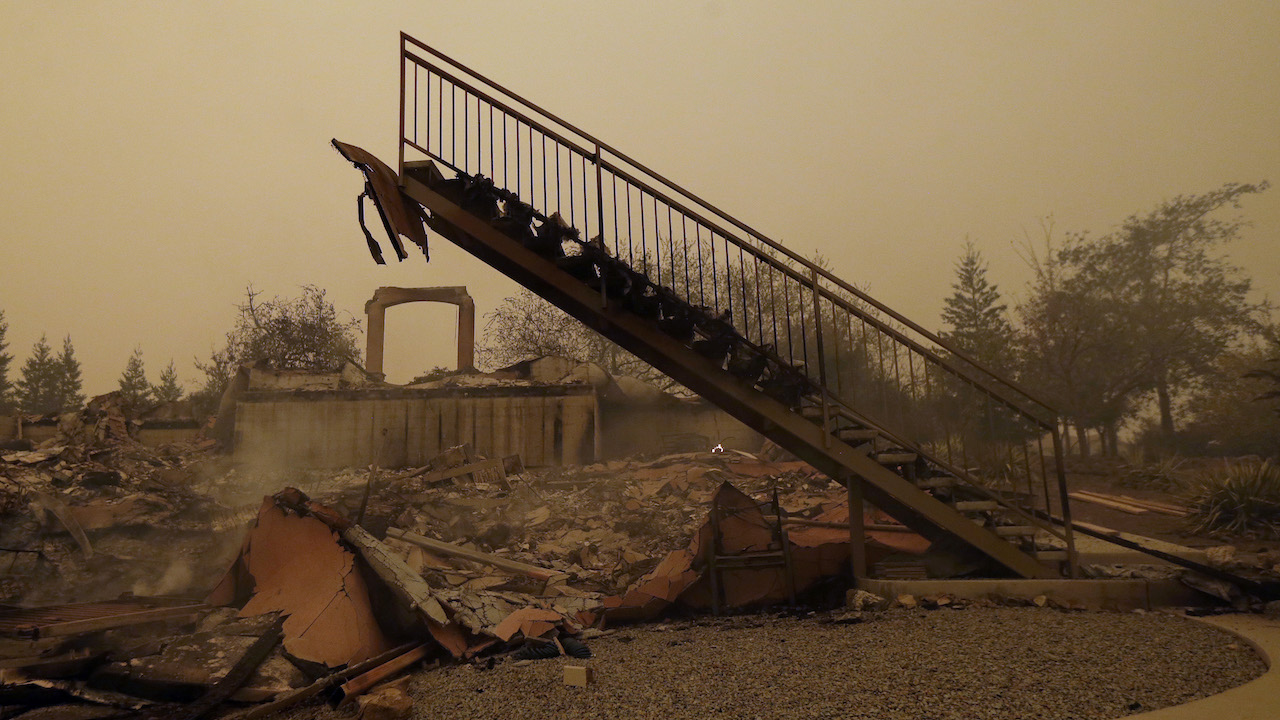 <div class='meta'><div class='origin-logo' data-origin='AP'></div><span class='caption-text' data-credit='AP Photo/Rich Pedroncelli'>A staircase that once led to another level is seen among the burned remains of a home Friday, Nov. 9, 2018.</span></div>