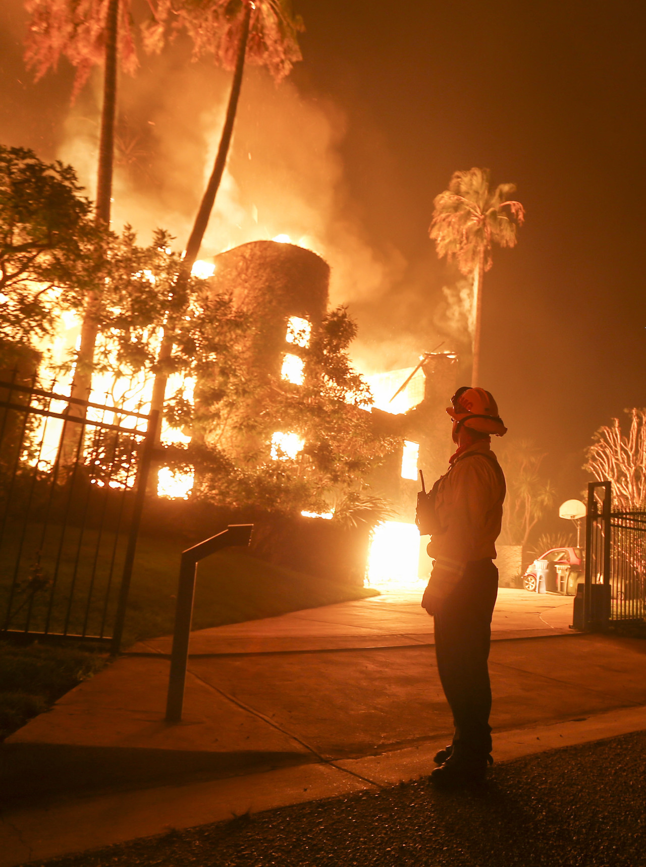 <div class='meta'><div class='origin-logo' data-origin='AP'></div><span class='caption-text' data-credit='AP Photo/Ringo H.W. Chiu'>A firefighter keeps watch as the Woolsey Fire burns a home in Malibu, Calif., Friday, Nov. 9, 2018.</span></div>