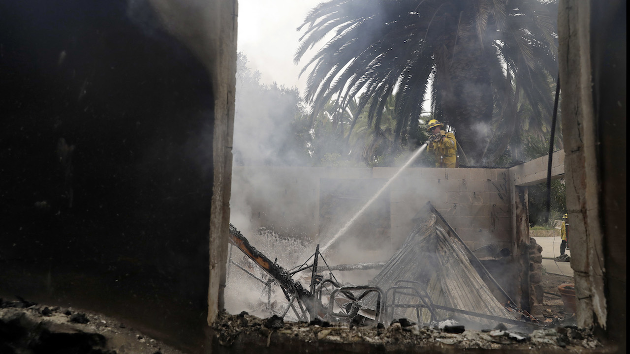 <div class='meta'><div class='origin-logo' data-origin='AP'></div><span class='caption-text' data-credit='AP Photo/Marcio Jose Sanchez'>Kevin Brown, with the Los Angeles Fire Dept., hoses down hot spots on a wildfire ravaged home Saturday, Nov. 10, 2018, in Malibu, Calif.</span></div>