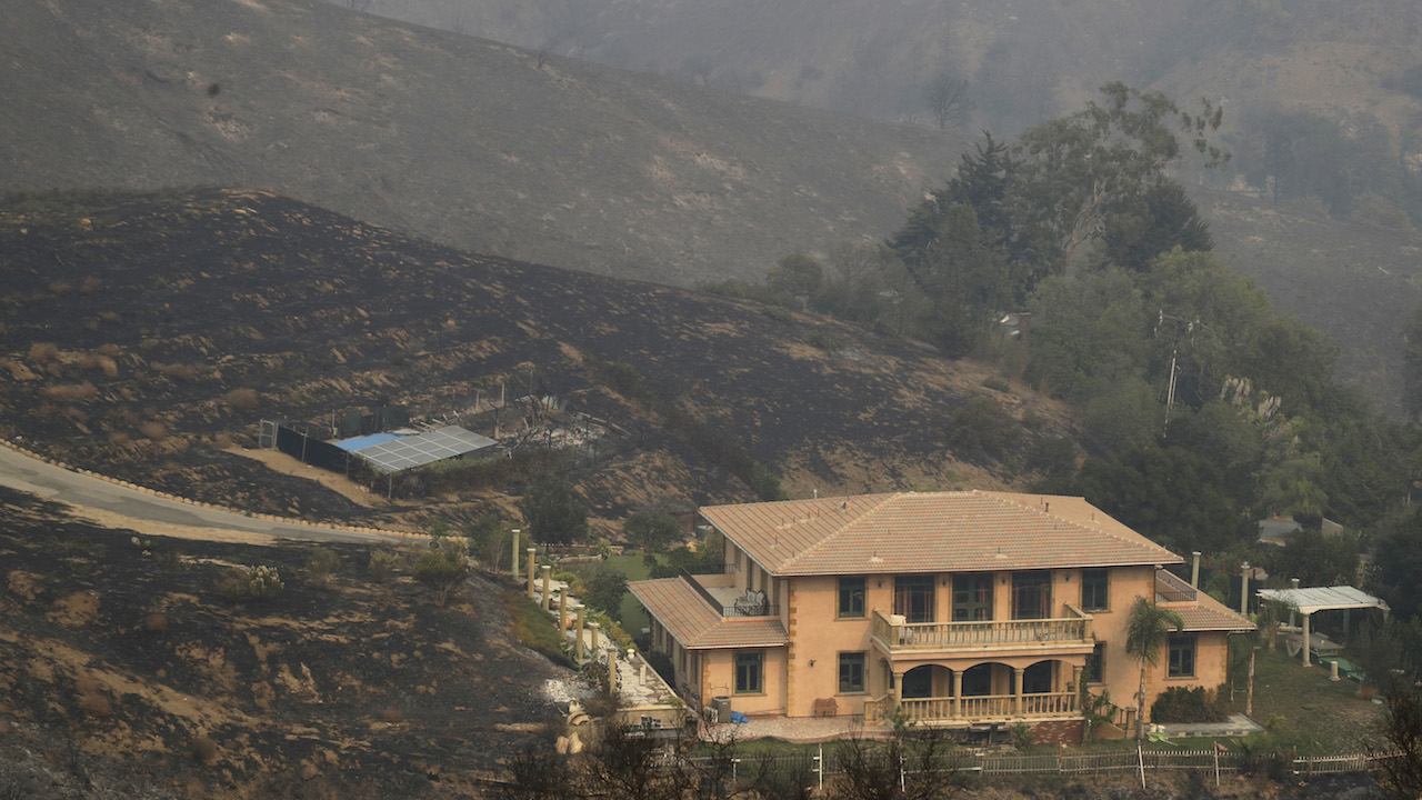 <div class='meta'><div class='origin-logo' data-origin='AP'></div><span class='caption-text' data-credit='AP Photo/Marcio Jose Sanchez'>A home is spared after a wildfire swept through Saturday, Nov. 10, 2018, in Malibu, Calif.</span></div>