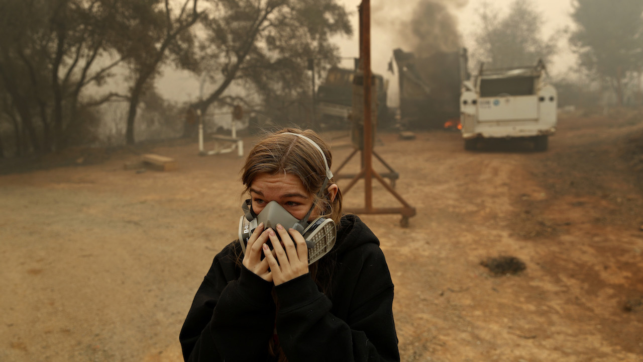 <div class='meta'><div class='origin-logo' data-origin='AP'></div><span class='caption-text' data-credit='AP Photo/John Locher'>Araya Cipollini cries near the remains of her family's home burned in the Camp Fire, Saturday, Nov. 10, 2018, in Paradise, Calif.</span></div>