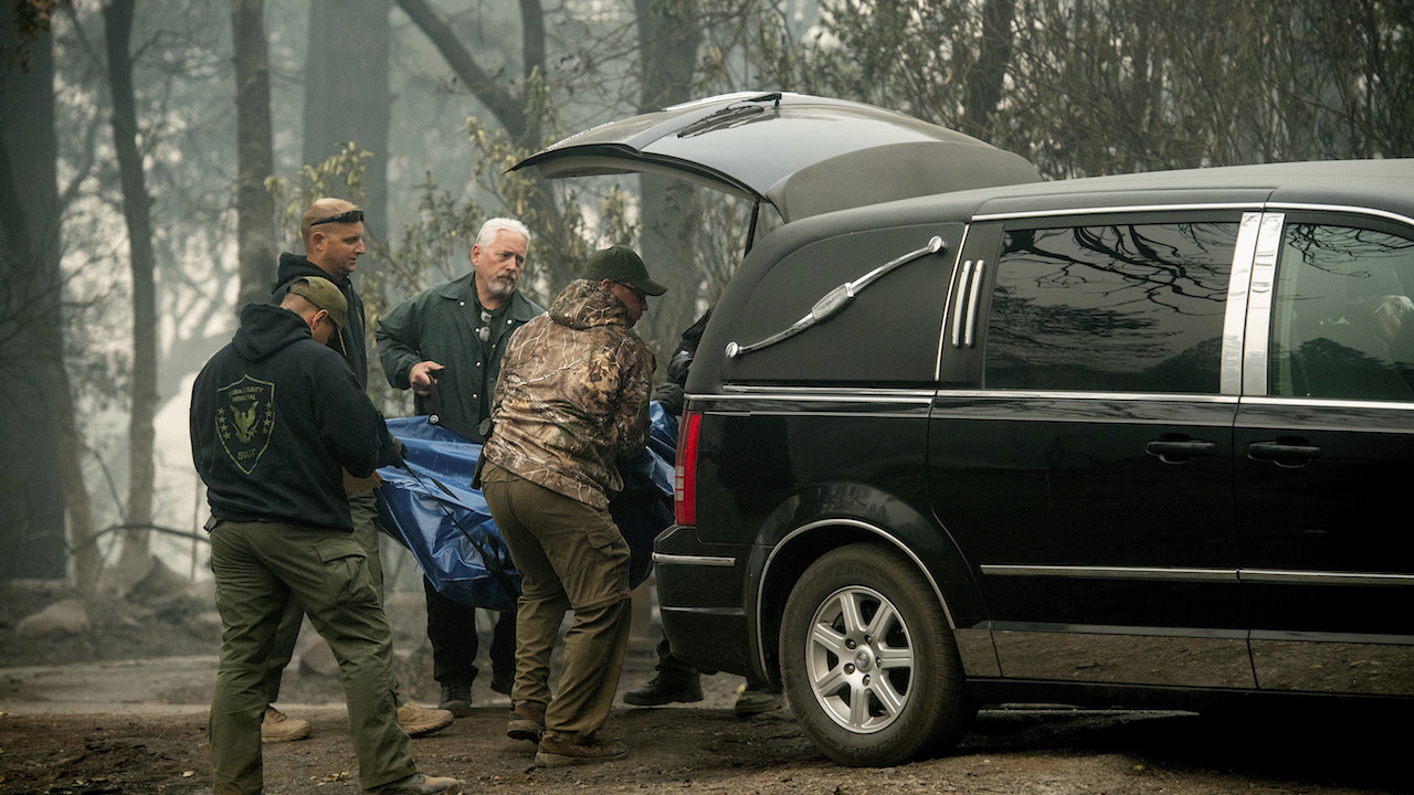 <div class='meta'><div class='origin-logo' data-origin='AP'></div><span class='caption-text' data-credit='AP Photo/Noah Berger'>Sheriff's deputies carry the remains of a victim of the Camp Fire into a hearse on Saturday, Nov. 10, 2018, in Paradise, Calif.</span></div>