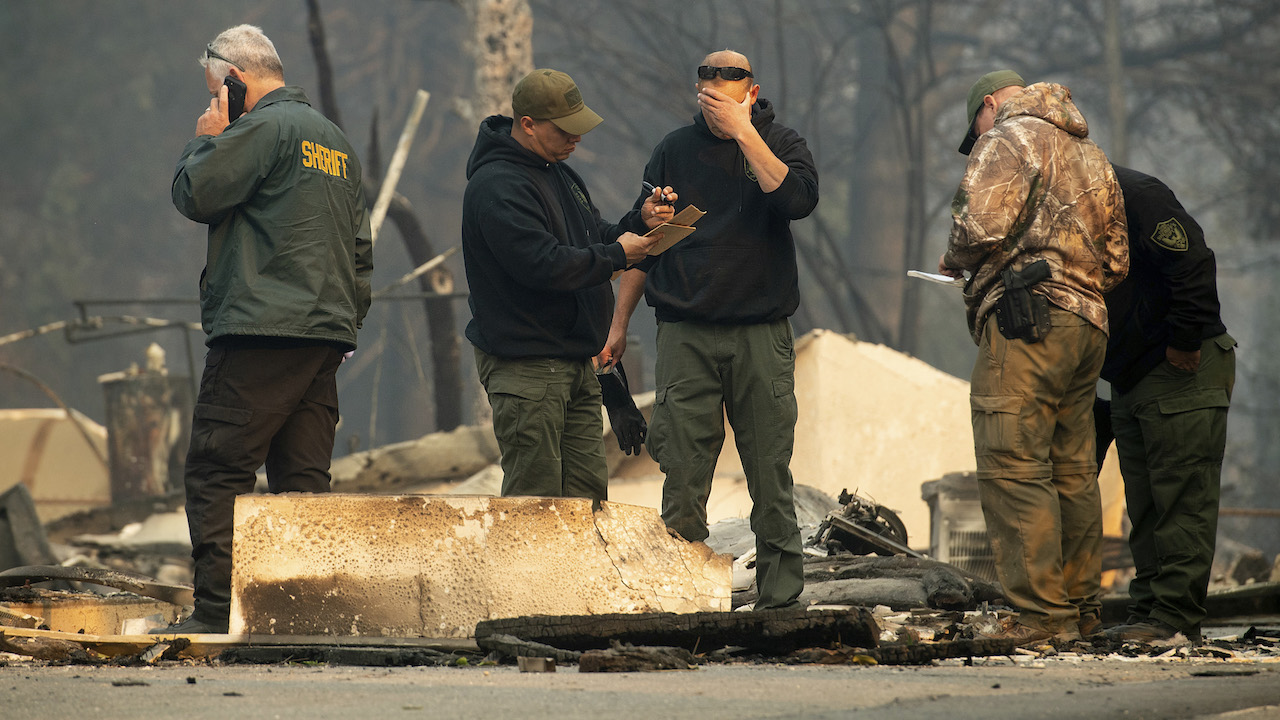 <div class='meta'><div class='origin-logo' data-origin='AP'></div><span class='caption-text' data-credit='AP Photo/Noah Berger'>Sheriff's deputies recover the remains of Camp Fire victims on Saturday, Nov. 10, 2018, in Paradise, Calif.</span></div>