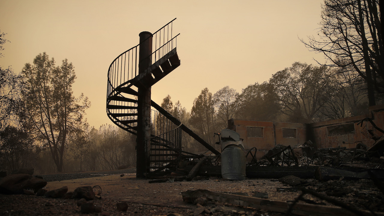 <div class='meta'><div class='origin-logo' data-origin='AP'></div><span class='caption-text' data-credit='AP Photo/John Locher'>A spiral staircase stands in the remains of a burned out home from the Camp Fire Saturday, Nov. 10, 2018, in Paradise, Calif.</span></div>