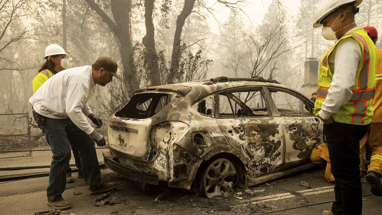 <div class='meta'><div class='origin-logo' data-origin='AP'></div><span class='caption-text' data-credit='AP Photo/Noah Berger'>Eric England searches through a friend's vehicle on Pearson Rd. after the wildfire burned through Paradise, Calif., on Saturday, Nov. 10, 2018.</span></div>