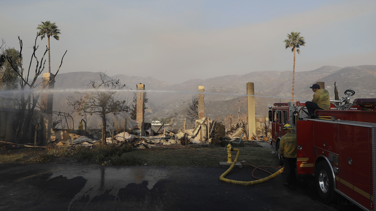 <div class='meta'><div class='origin-logo' data-origin='AP'></div><span class='caption-text' data-credit='AP Photo/Marcio Jose Sanchez'>Firefighters hose down hot spots on a wildfire-ravaged property Saturday, Nov. 10, 2018, in Malibu, Calif.</span></div>