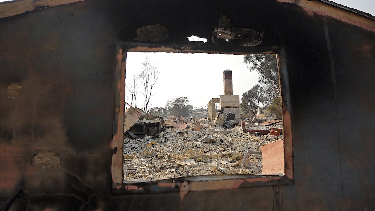<div class='meta'><div class='origin-logo' data-origin='AP'></div><span class='caption-text' data-credit='AP Photo/Reed Saxon'>A wall and a window frame are all that remains one of at least 20 homes destroyed just on Windermere Drive in the Point Dume area of Malibu, Calif.</span></div>