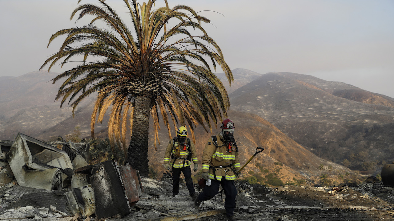 <div class='meta'><div class='origin-logo' data-origin='AP'></div><span class='caption-text' data-credit='AP Photo/Marcio Jose Sanchez'>Firefighters Jason Toole, right, and Brent McGill with the Santa Barbara Fire Dept. walk among the ashes of a wildfire-ravaged home.</span></div>