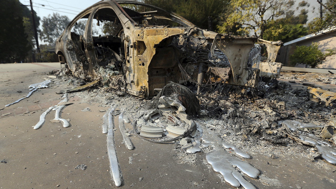 <div class='meta'><div class='origin-logo' data-origin='AP'></div><span class='caption-text' data-credit='AP Photo/Reed Saxon'>Molten aluminum has flowed from a car that burned in front of one of at least 20 homes destroyed just on Windermere Drive in the Point Dume area of Malibu, Calif.</span></div>
