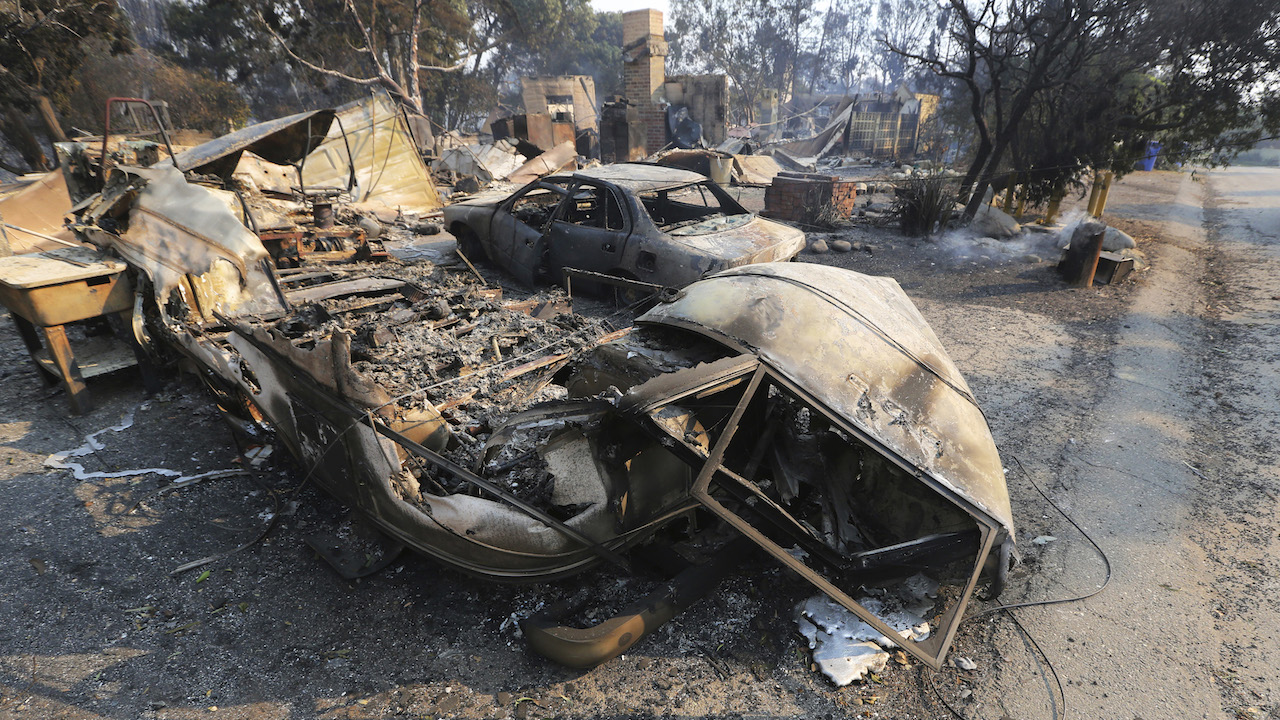 <div class='meta'><div class='origin-logo' data-origin='AP'></div><span class='caption-text' data-credit='AP Photo/Reed Saxon'>Vehicles and a home are in ruins, one of at least 20 homes that were lost on Windermere Drive in the Point Dume area of Malibu, Calif., Saturday, Nov. 10, 2018.</span></div>
