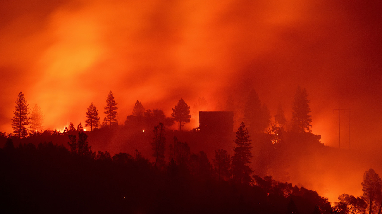 <div class='meta'><div class='origin-logo' data-origin='Creative Content'></div><span class='caption-text' data-credit='Josh Edelson/AFP/Getty Images'>Flames from the Camp Fire burn near a home atop a ridge near Big Bend, California, on November 10, 2018.</span></div>
