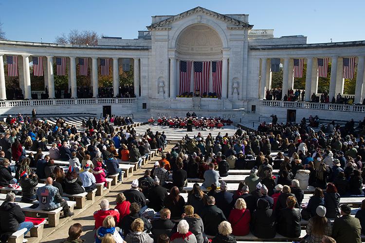 <div class='meta'><div class='origin-logo' data-origin='AP'></div><span class='caption-text' data-credit='(AP Photo/Cliff Owen)'>An audience attends the National Veterans Day Observance at Arlington National Cemetery Amphitheater in Arlington, Va., Sunday, Nov. 11, 2018.</span></div>