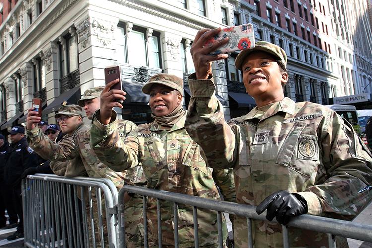 <div class='meta'><div class='origin-logo' data-origin='AP'></div><span class='caption-text' data-credit='(AP Photo/Tina Fineberg)'>Veteran Mariecha Rowe-Watson, of New York, right, watches as the Veterans Day Parade makes its way up New York's Fifth Avenue Sunday, Nov. 11, 2018.</span></div>