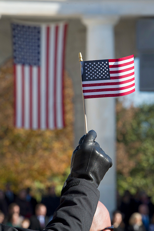 <div class='meta'><div class='origin-logo' data-origin='AP'></div><span class='caption-text' data-credit='(AP Photo/Cliff Owen)'>An American flag is held during the National Veterans Day Observance at Arlington National Cemetery in Arlington, Va., Sunday, Nov. 11, 2018.</span></div>