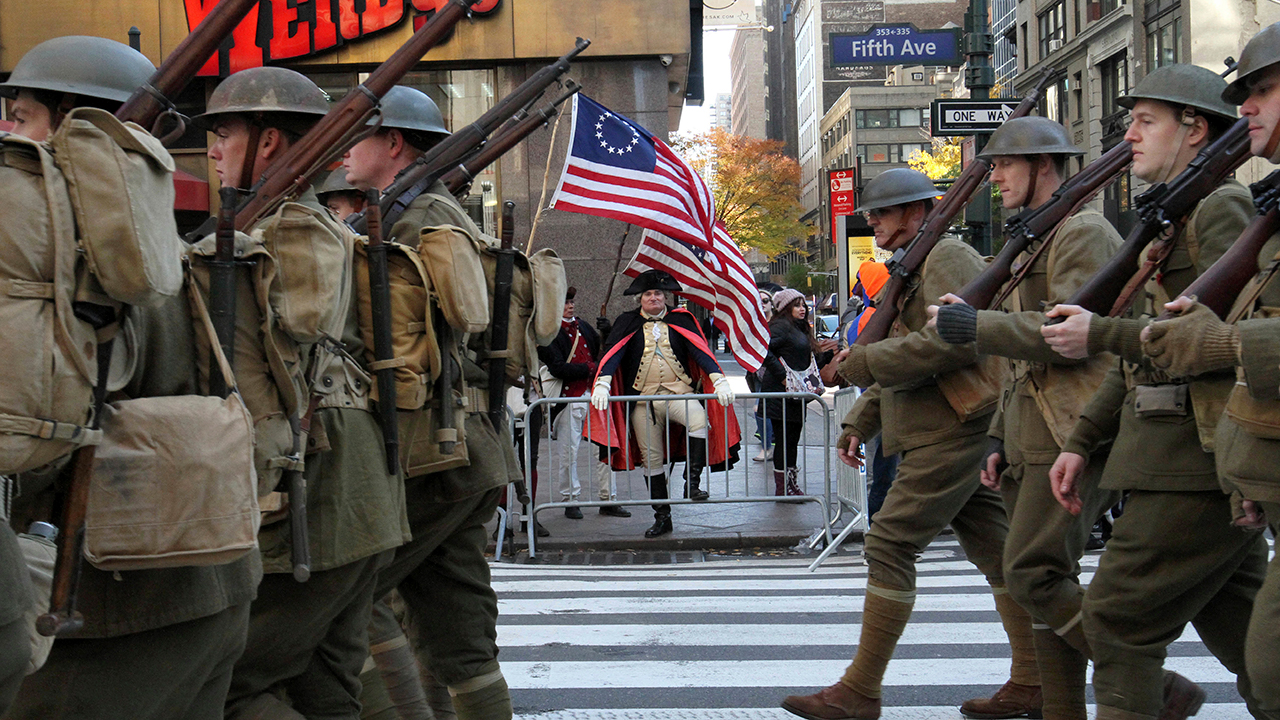 <div class='meta'><div class='origin-logo' data-origin='AP'></div><span class='caption-text' data-credit='(AP Photo/Tina Fineberg)'>Dressed as General George Washington, Michael Drillo, of Scarsdale, New York, center, watches as the Veterans Day Parade makes its way up New York's Fifth Avenue.</span></div>