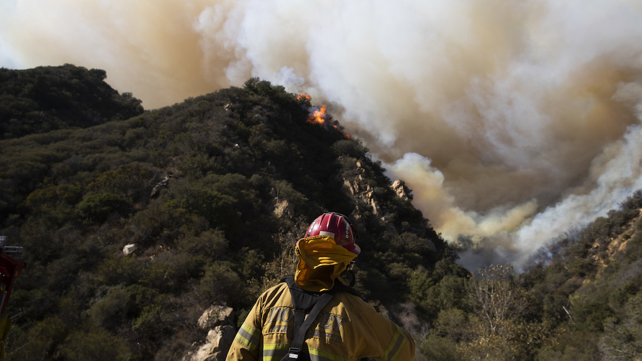 <div class='meta'><div class='origin-logo' data-origin='AP'></div><span class='caption-text' data-credit='AP Photo/Jae C. Hong'>A firefighter monitors a wildfire burning along a hillside Sunday, Nov. 11, 2018, in Malibu, Calif.</span></div>