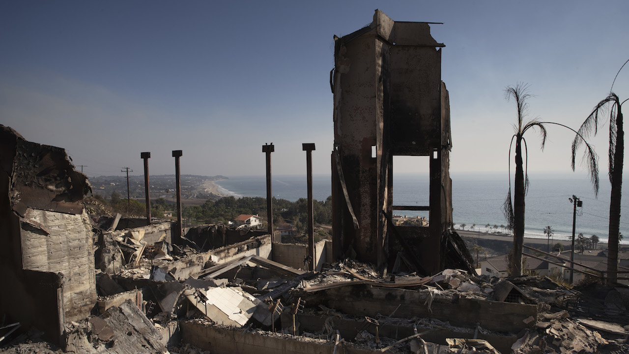 <div class='meta'><div class='origin-logo' data-origin='AP'></div><span class='caption-text' data-credit='AP Photo/Jae C. Hong'>A home burned down by a wildfire sits on a hilltop overlooking the Pacific Ocean, Sunday, Nov. 11, 2018, in Malibu, Calif.</span></div>