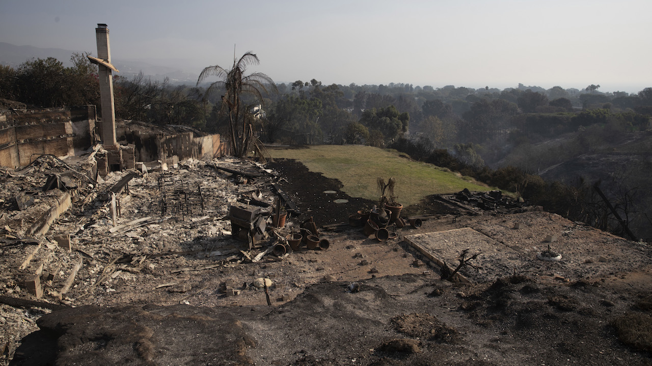 <div class='meta'><div class='origin-logo' data-origin='AP'></div><span class='caption-text' data-credit='AP Photo/Jae C. Hong'>A home overlooking the Pacific Ocean is consumed by a wildfire Sunday, Nov. 11, 2018, in Malibu, Calif.</span></div>