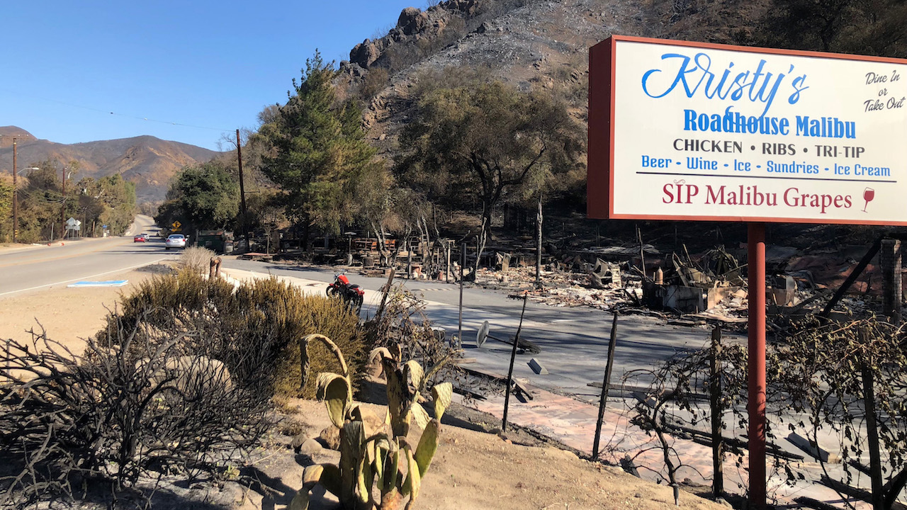<div class='meta'><div class='origin-logo' data-origin='AP'></div><span class='caption-text' data-credit='AP Photo/Christopher Weber'>The sign is all that remains of Kristy's Roadhouse Malibu restaurant, Sunday, Nov. 11, 2018, after flames tore across hillsides in canyon areas in Agoura Hills, Calif.</span></div>