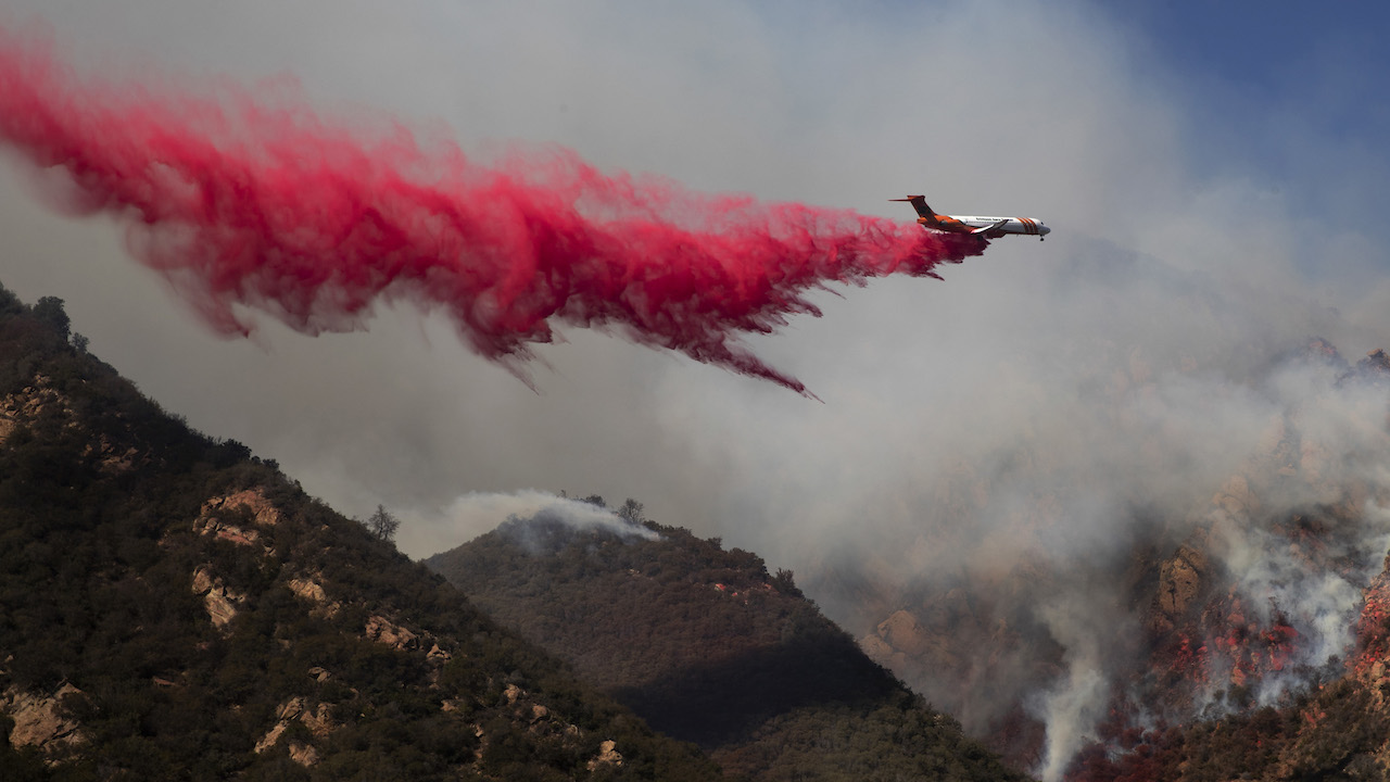 <div class='meta'><div class='origin-logo' data-origin='AP'></div><span class='caption-text' data-credit='AP Photo/Jae C. Hong'>A plane drops fire retardant on a burning hillside Sunday, Nov. 11, 2018, in Malibu, Calif.</span></div>