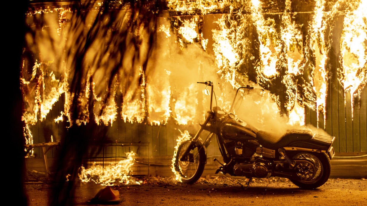 <div class='meta'><div class='origin-logo' data-origin='Creative Content'></div><span class='caption-text' data-credit='Kyle Grillot /The Washington Post/Getty Images'>A structure and a motorcycle burn at an RV park during the Woolsey Fire in Malibu, California, November 10, 2018.</span></div>