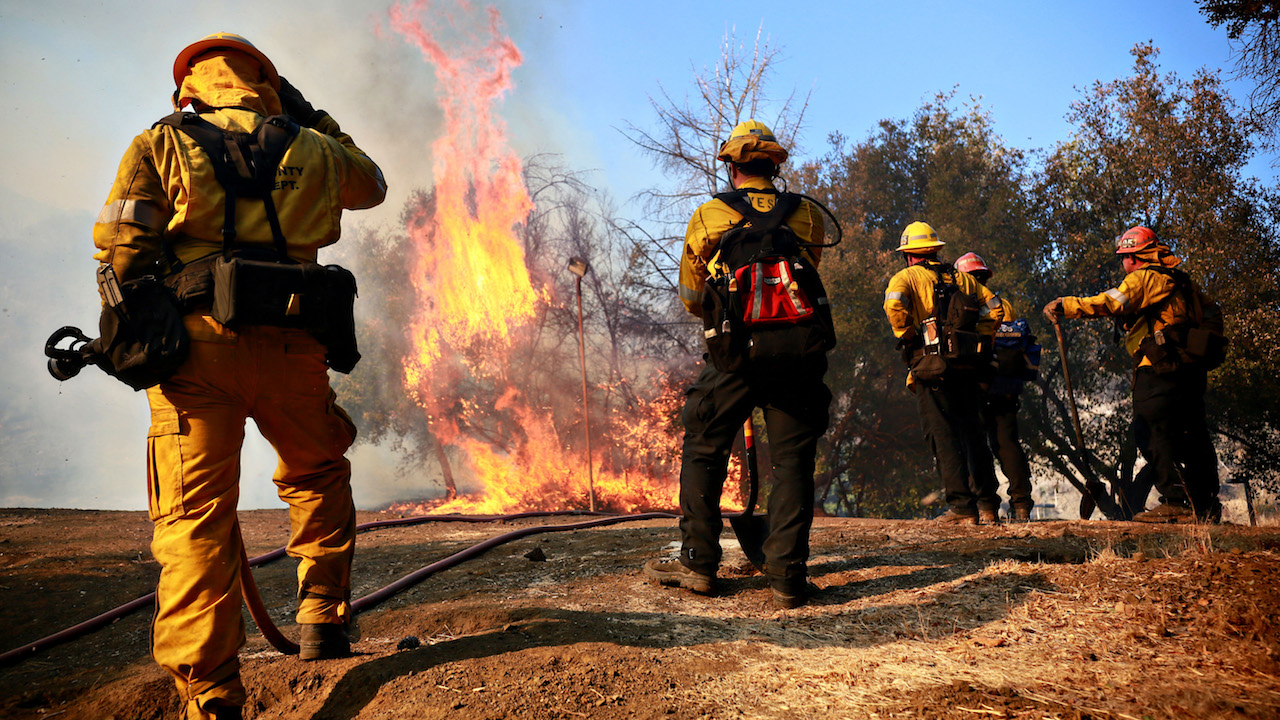 <div class='meta'><div class='origin-logo' data-origin='Creative Content'></div><span class='caption-text' data-credit='Sandy Huffaker/Getty Images'>Firefighters battle a blaze at the Salvation Army Camp on November 10, 2018, in Malibu, California.</span></div>