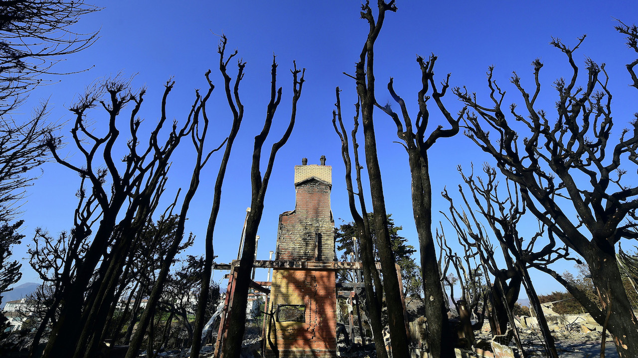 <div class='meta'><div class='origin-logo' data-origin='Creative Content'></div><span class='caption-text' data-credit='Frederic J. Brown/AFP/Getty Images'>The remains of a luxury home stand amid burnt out tree trunks in the beachside community of Point Dume in Malibu, California.</span></div>