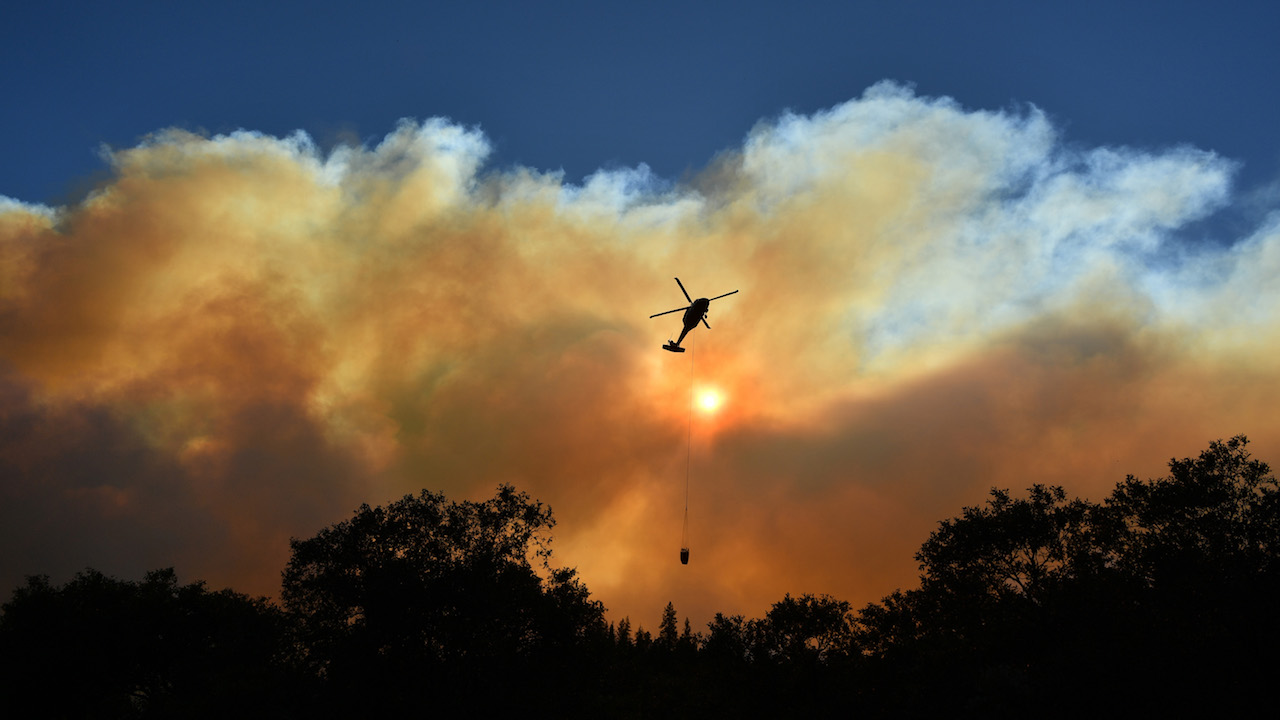 <div class='meta'><div class='origin-logo' data-origin='Creative Content'></div><span class='caption-text' data-credit='Josh Edelson/AFP/Getty Images'>A helicopter passes by the sun as it makes a water drop in the Feather River Canyon, east of Paradise, California on November 11, 2018.</span></div>