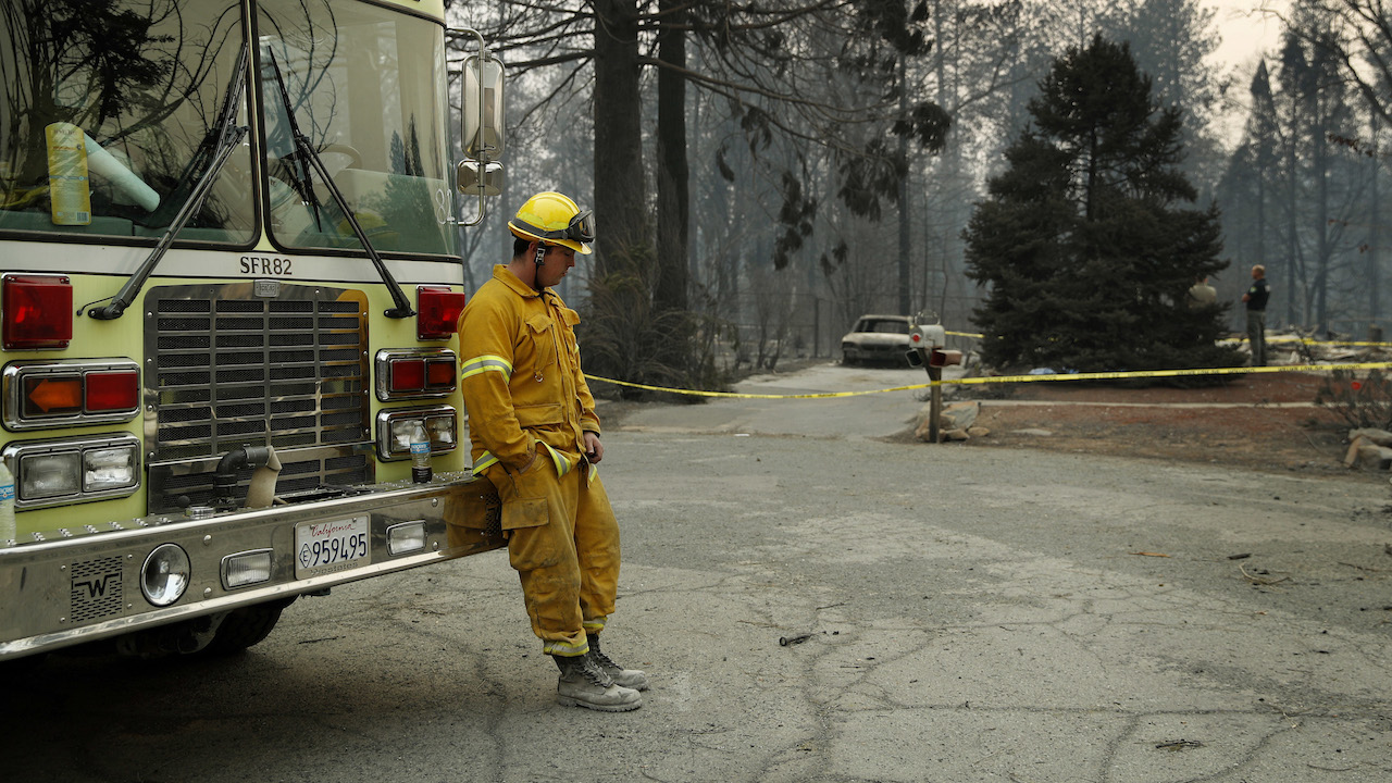 <div class='meta'><div class='origin-logo' data-origin='AP'></div><span class='caption-text' data-credit='AP Photo/John Locher'>A firefighter rests after helping to find human remains found at a burned-out home at the Camp Fire, Sunday, Nov. 11, 2018, in Paradise, Calif.</span></div>