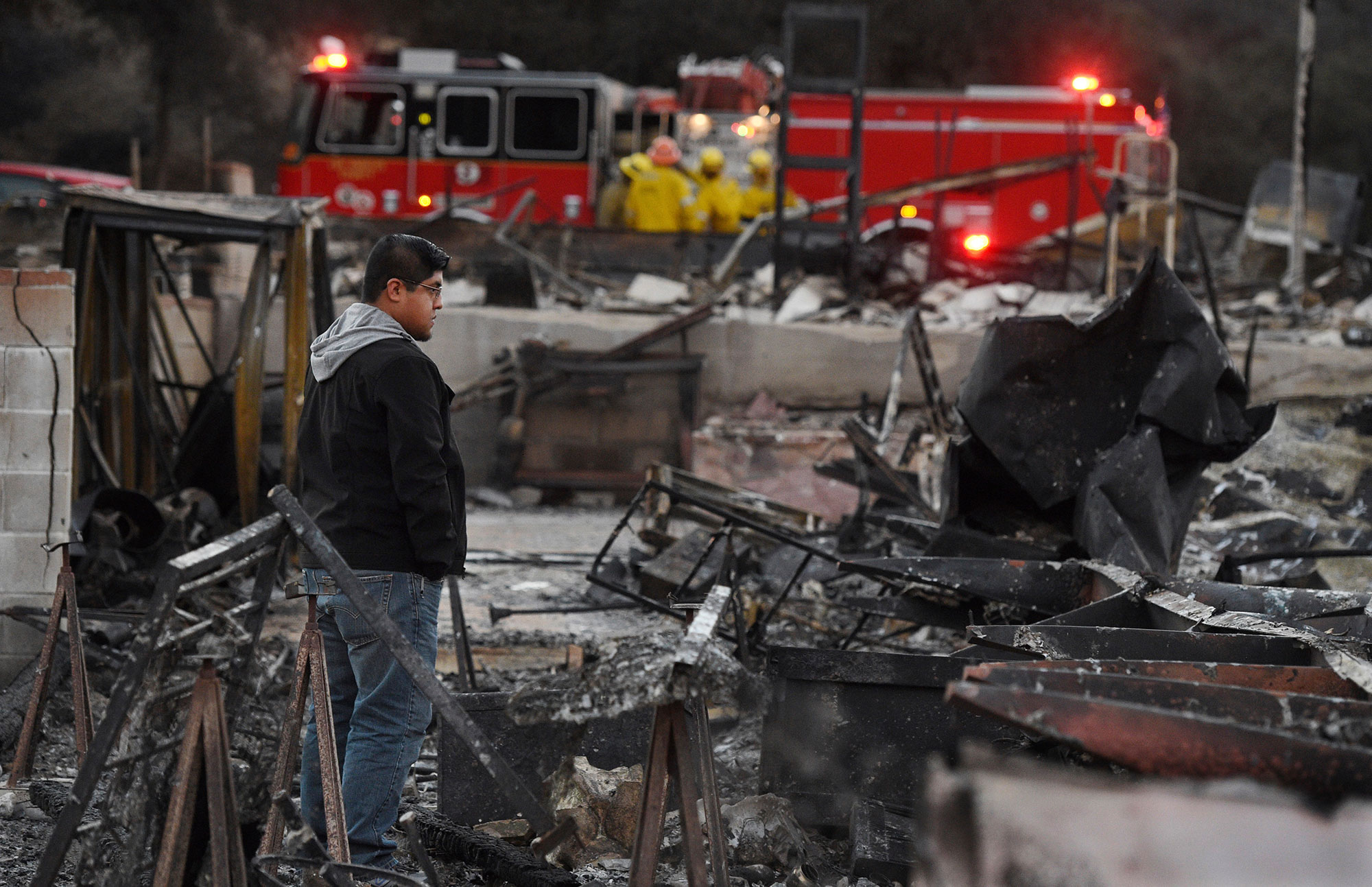 <div class='meta'><div class='origin-logo' data-origin='none'></div><span class='caption-text' data-credit='Chris Pizzello/AP Photo'>Ricky Alvarado looks over the charred remains of his home at the Seminole Springs Mobile Home Park, Sunday, Nov. 11, 2018.</span></div>