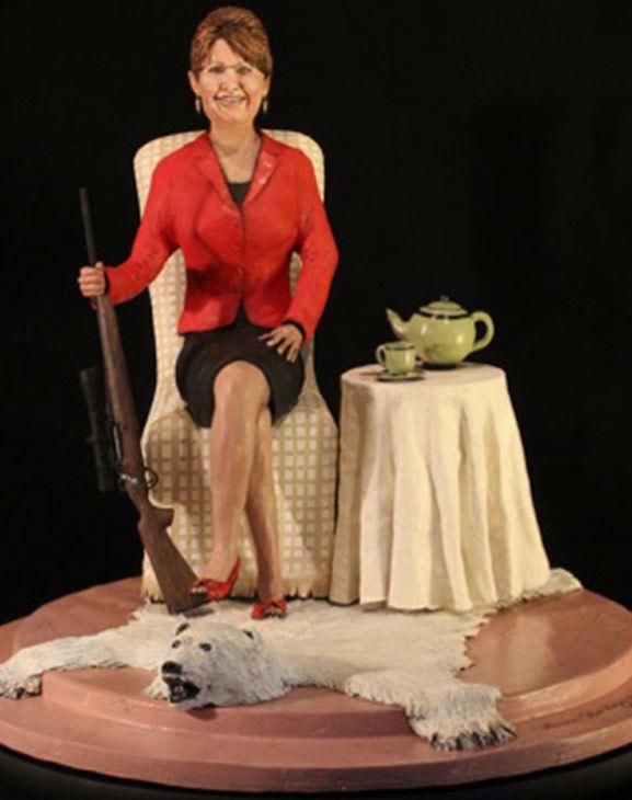 """<div class=""""meta image-caption""""><div class=""""origin-logo origin-image """"><span></span></div><span class=""""caption-text"""">A sculpture depicts Sarah Palin with a gun, polar bear rug and tea set. (Laura Harling)</span></div>"""