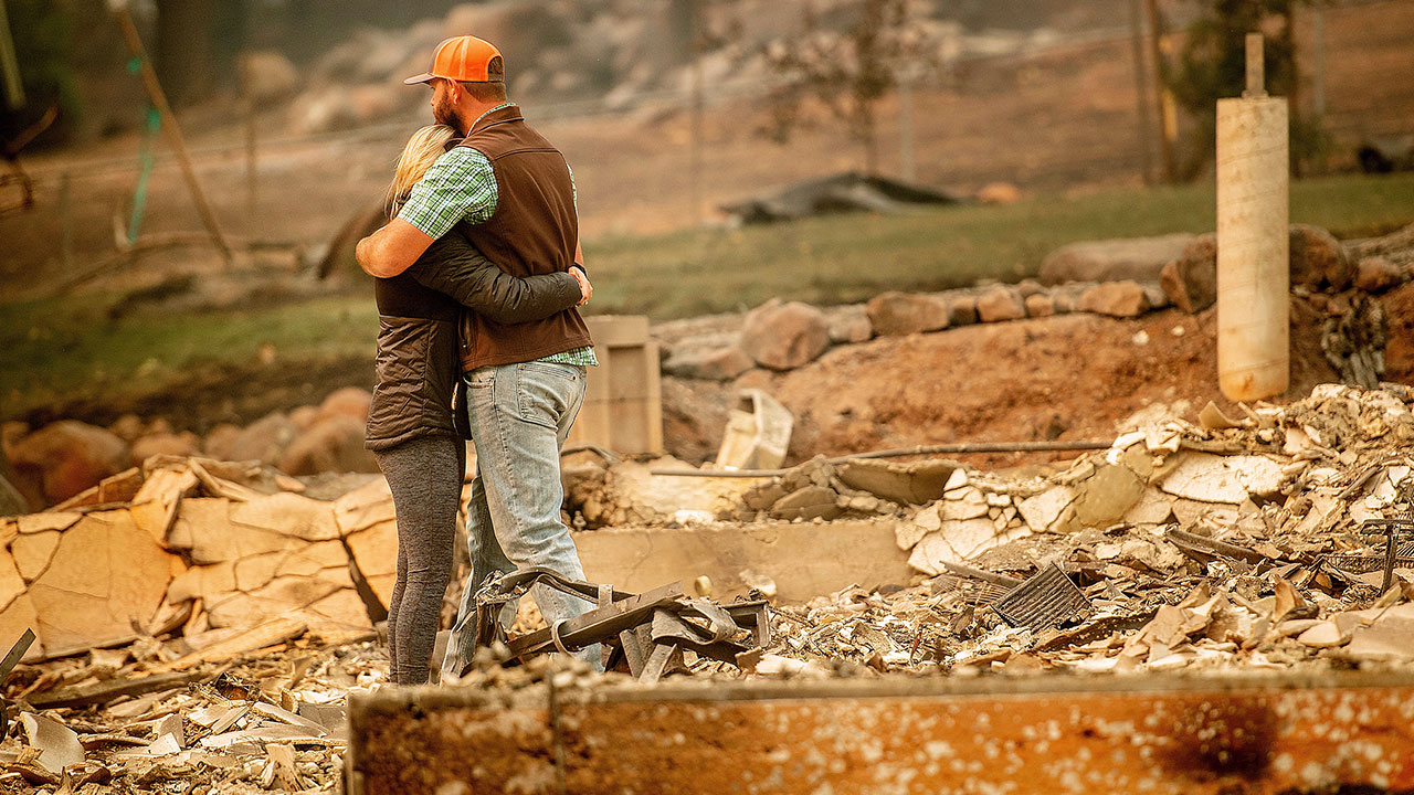 <div class='meta'><div class='origin-logo' data-origin='none'></div><span class='caption-text' data-credit='Noah Berger/AP Photo'>Chris and Nancy Brown embrace while searching through the remains of their home, leveled by the Camp Fire, in Paradise, Calif., on Monday, Nov. 12, 2018.</span></div>