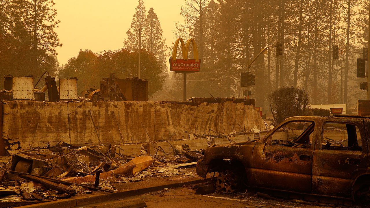 <div class='meta'><div class='origin-logo' data-origin='none'></div><span class='caption-text' data-credit='John Locher/AP Photo'>A sign still stands at a McDonald's restaurant burned in the Camp Fire, Monday, Nov. 12, 2018, in the northern California town of Paradise.</span></div>