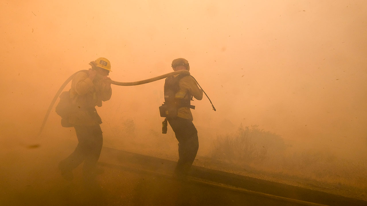 <div class='meta'><div class='origin-logo' data-origin='none'></div><span class='caption-text' data-credit='Ringo H.W. Chiu/AP Photo'>Firefighters battle a fire along the Ronald Reagan (118) Freeway in Simi Valley, Calif., Monday, Nov. 12, 2018.</span></div>