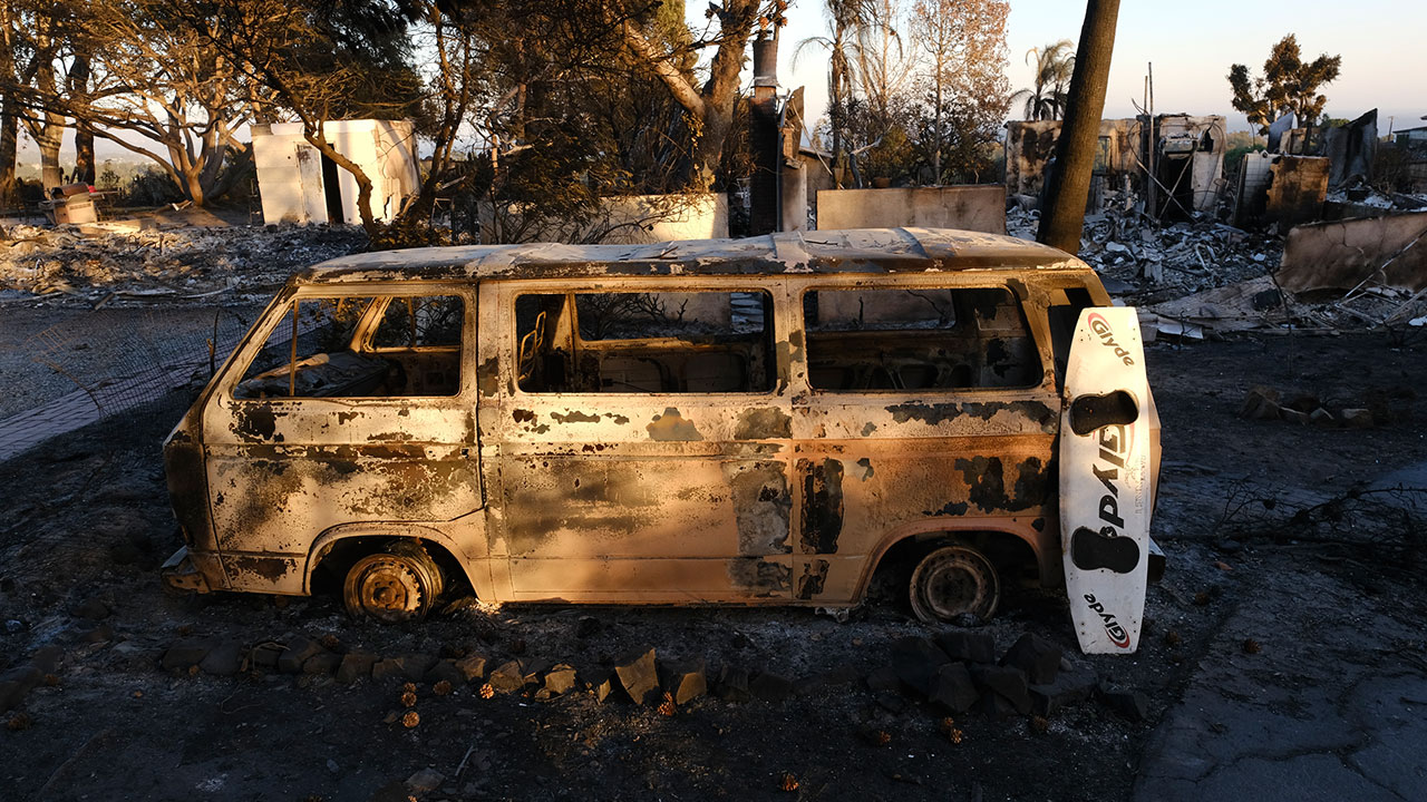 <div class='meta'><div class='origin-logo' data-origin='none'></div><span class='caption-text' data-credit='Richard Vogel/AP Photo'>A burned surfboard and a van are all that remain in the front of a destroyed home in the Point Dome neighborhood in Malibu, Calif., Monday, Nov. 12, 2018.</span></div>