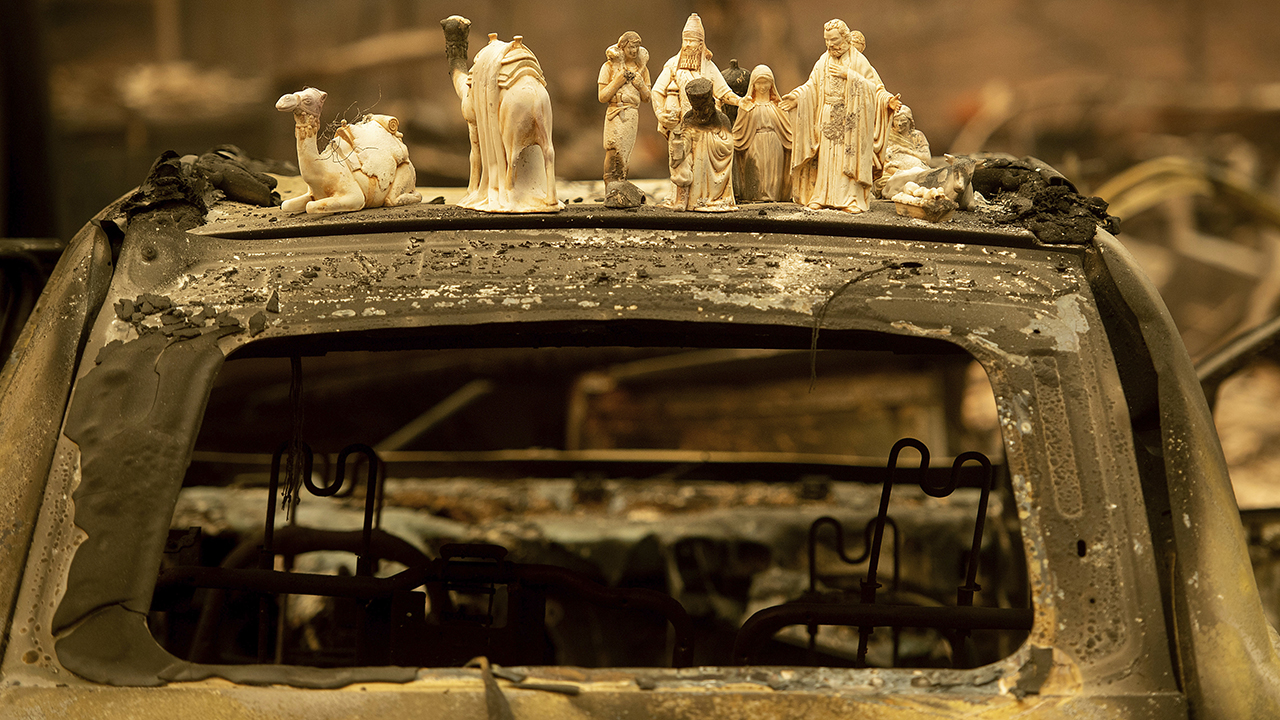 <div class='meta'><div class='origin-logo' data-origin='AP'></div><span class='caption-text' data-credit='AP Photo/Noah Berger'>Following the Camp Fire, figurines rest atop a scorched car on Pearson Road, Monday, Nov. 12, 2018, in Paradise, Calif.</span></div>