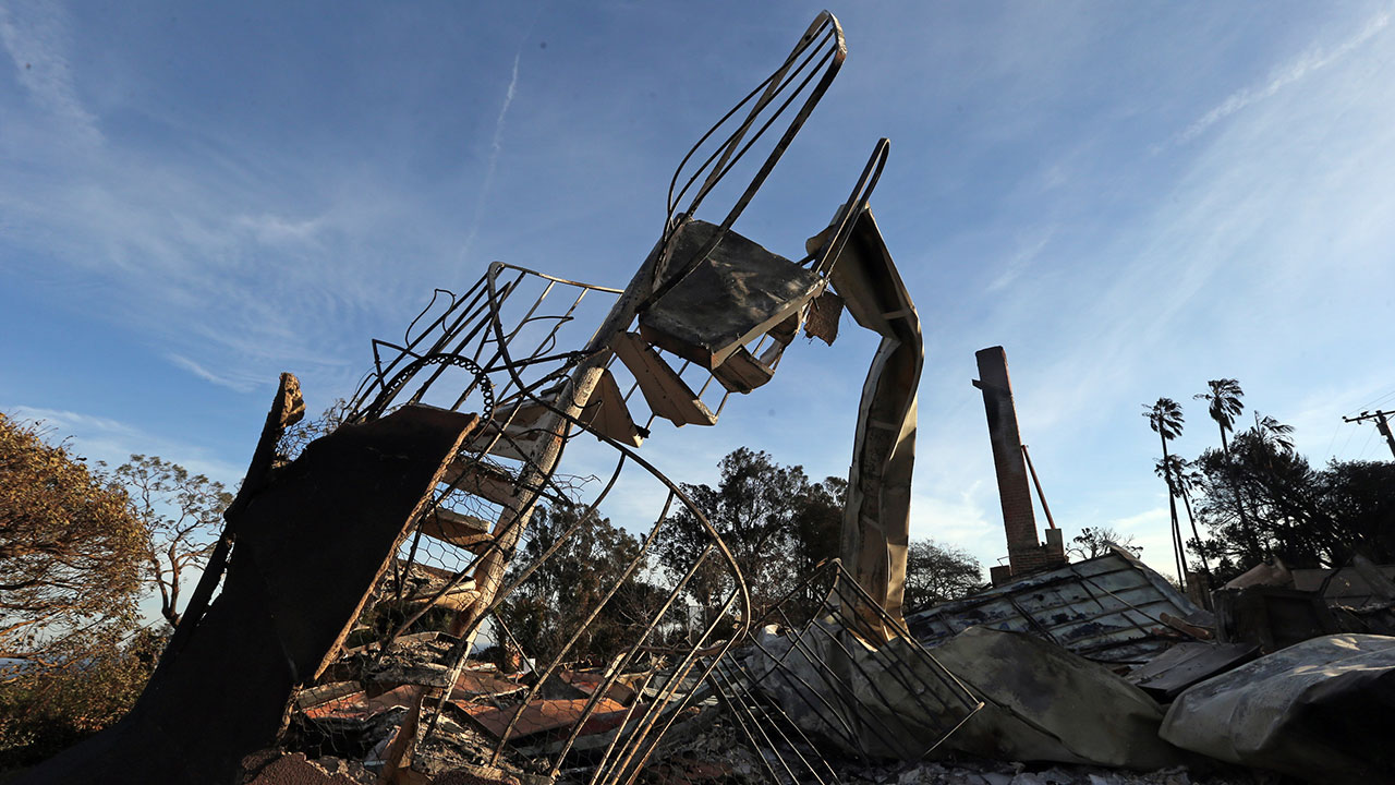 <div class='meta'><div class='origin-logo' data-origin='none'></div><span class='caption-text' data-credit='Reed Saxon/AP Photo'>The ruins of a spiral staircase and a chimney are seen at a home destroyed by the Woolsey fire on Dume Drive in the Point Dume area of Malibu in Southern California on Nov. 13.</span></div>
