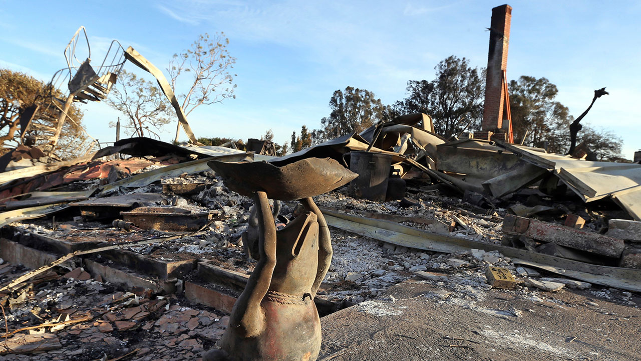 <div class='meta'><div class='origin-logo' data-origin='none'></div><span class='caption-text' data-credit='Reed Saxon/AP Photo'>A metal figure of a frog stands outside a home destroyed by the Woolsey fire on Dume Drive in the Point Dume area of Malibu in Southern California Tuesday, Nov. 13, 2018.</span></div>