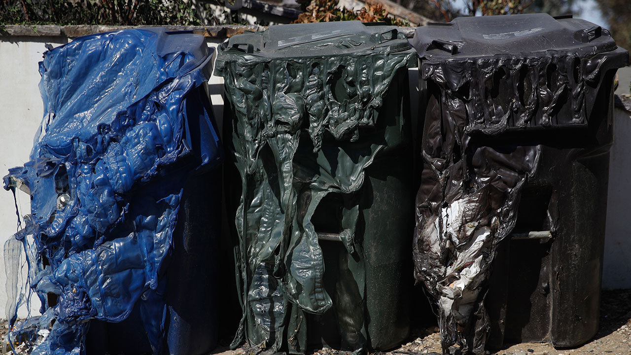 <div class='meta'><div class='origin-logo' data-origin='none'></div><span class='caption-text' data-credit='Jae C. Hong/AP Photo'>Melted trash bins stand in front of a home burned down by the Woolsey Fire Tuesday, Nov. 13, 2018, in Agoura Hills, Calif.</span></div>